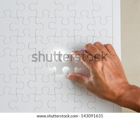 Missing jigsaw puzzle piece with light glow,Success concept - stock photo