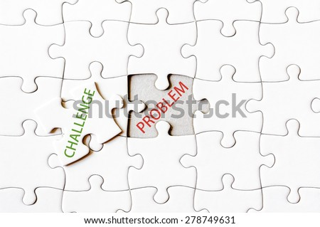 Missing jigsaw puzzle piece with word CHALLENGE, covering text PROBLEM. Business concept image for completing the final puzzle piece.