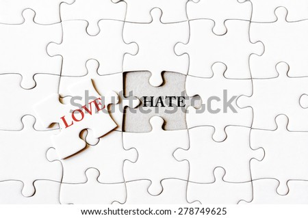 Missing jigsaw puzzle piece with word LOVE, covering text HATE. Business concept image for completing the final puzzle piece. - stock photo