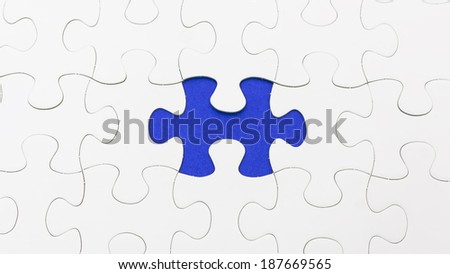 Missing puzzle in blue color. Selective focus - stock photo