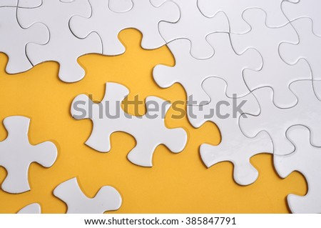 Missing Puzzle on Yellow Background, Searching a Solution and Business Concept - stock photo