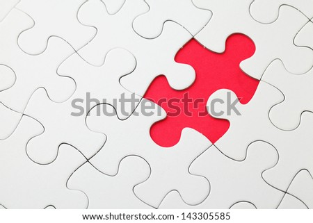 Missing puzzle piece in red - stock photo
