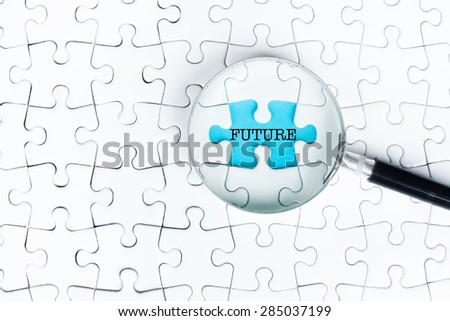 """Missing puzzle searching with magnifying glass with """"solved"""" words - stock photo"""
