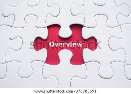 Missing puzzle with Overview word - stock photo