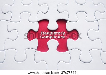 Missing puzzle with Regulatory Compliance word - stock photo