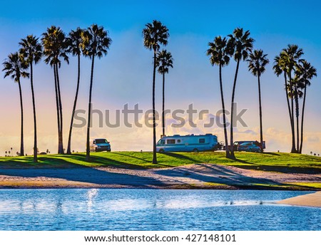 Mission Bay sunset and palm trees  San Diego, California USA.