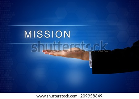 mission button with business hand on a touch screen interface - stock photo