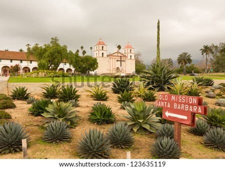 Mission Santa Barbara in California exterior on stormy day with clouds - stock photo