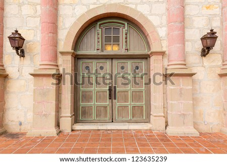 Mission Santa Barbara in California exterior on stormy day with details of main entrance doors - stock photo