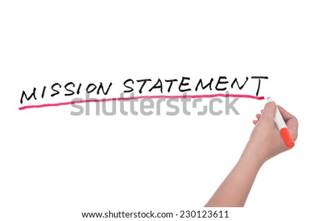 Mission statement words written on white board - stock photo