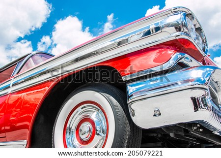 """MISSISSAUGA, CANADA - JULY 6 2014: Profile of a red 1958 Oldsmobile Super 88.  As seen at """"Classics on the Square"""", a car show at Celebration Square in Mississauga, Canada on July 6, 2014. - stock photo"""