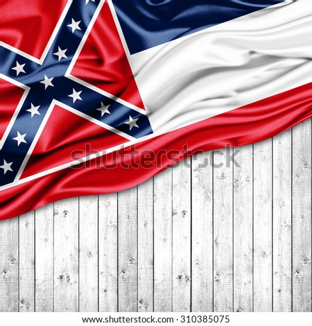 Mississippi flag of silk with copyspace for your text or images and wood background - stock photo