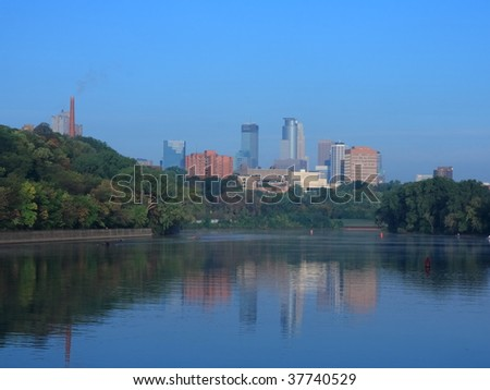 Mississippi river and downtown Minneapolis - stock photo