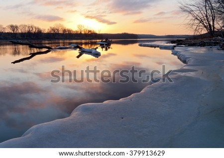 mississippi river in south saint paul minnesota at sunrise in winter along icy banks - stock photo