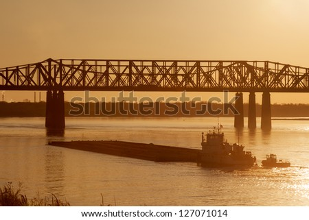 Mississippi river under old railroad bridge in Memphis, TN