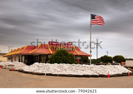 MISSOURI VALLEY, IA - JUNE 9:  A local McDonald's restaurant is surrounded by sand bags in defense of imminent flood waters by the Missouri River on June 9, 2011 in Missouri Valley, IA.