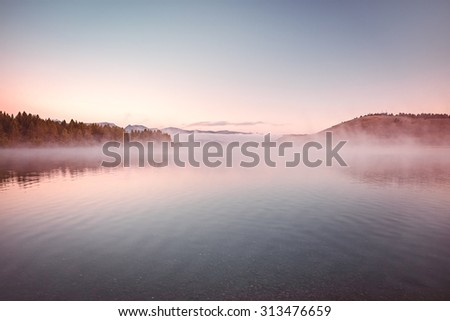 Mist and low morning clouds at Hebgen Lake, Montana, USA - stock photo