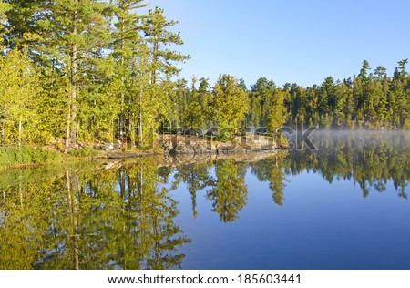 Mist and Reflections on Ottertrack Lake IN the Boundary Waters - stock photo
