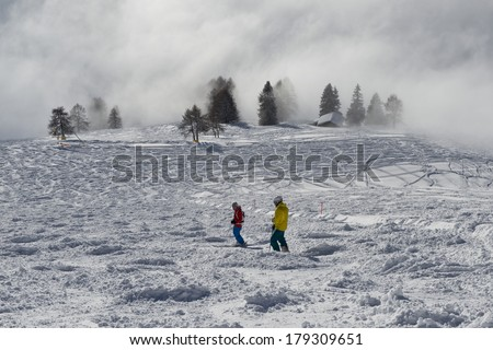 Mist on the ski slopes of Carezza, Trentino South Tyrol - stock photo