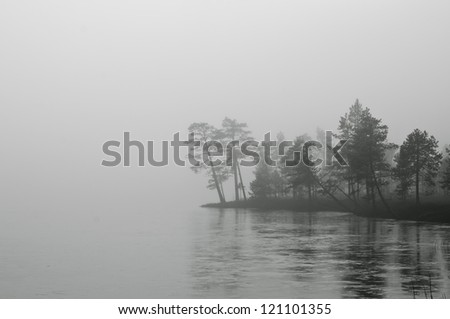 Mist over frozen lake, captured in Finland. - stock photo