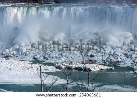 Mist rises off the Falls at in Niagara Falls. - stock photo