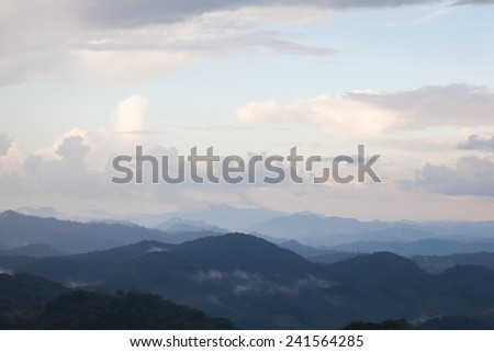 mist-shrouded mountains. High mountain complex. Fog in the morning and evening.