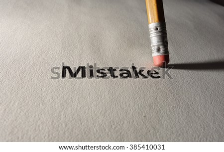 Mistake text on paper being erased by a pencil                                - stock photo