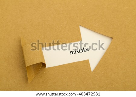 Mistake word under brown torn paper - stock photo