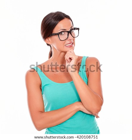 Mistaken caucasian woman with her hand to mouth while looking at the camera as if she made a mistake wearing her long hair tied back in a green tank top on a white background