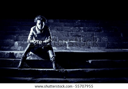misterious image of a young beautiful girl at night - stock photo