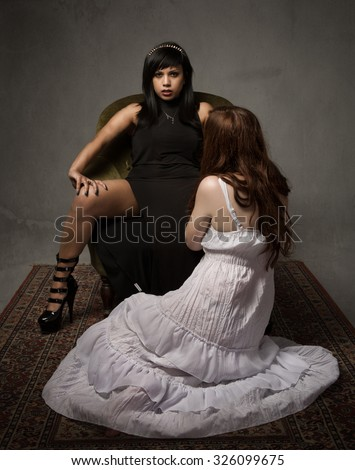 mistress and her slave concept, dark background - stock photo