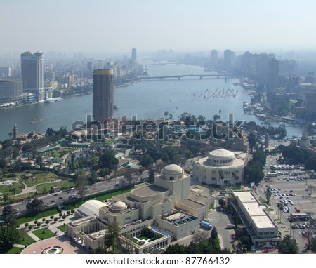 misty aerial view of Cairo in Egypt, seen from Gezira. It includes the Nile river in sunny ambiance - stock photo