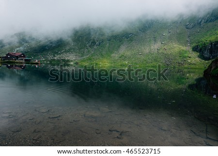misty and foggy lake in transylvania, carpathians