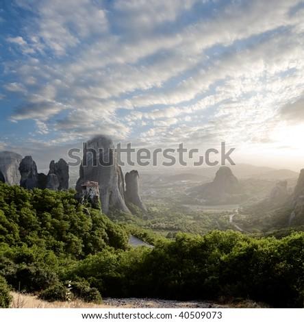 misty at sunset of hot day on Moni Agias Varvaras Roussanou on top of rock Meteora, Greece - stock photo
