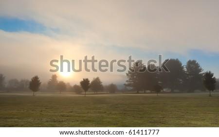 Misty autumn morning sunrise - stock photo