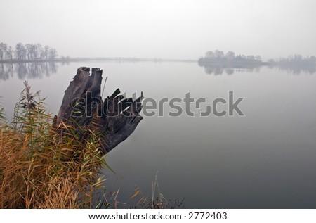 Misty Autumn Pond - stock photo