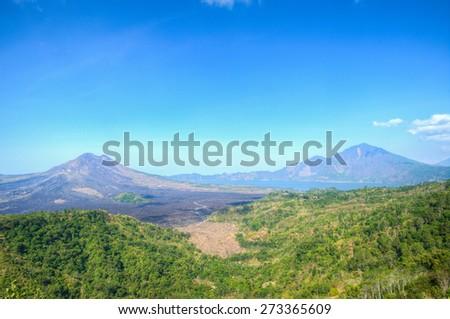 Misty Batur volcano mountain and Abang mountain from Kintamani, Bali, Indonesia - stock photo
