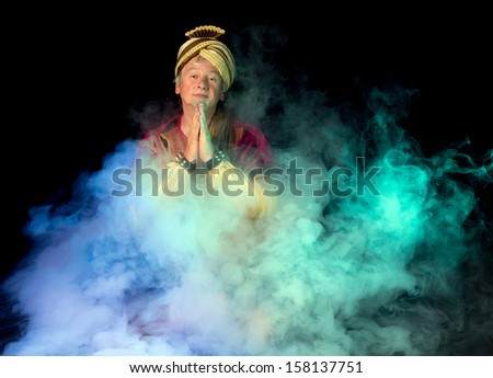 Misty clouds and an arabian ghost emerging - stock photo