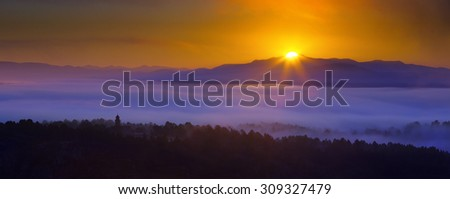 Misty dawn over wooded mountains.  Galicia, Spain