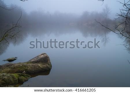 Misty day on a lake - stock photo