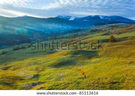 Misty early daybreak in autumn Carpathian mountain, Ukraine (Goverla and Petros Mount in far) - stock photo