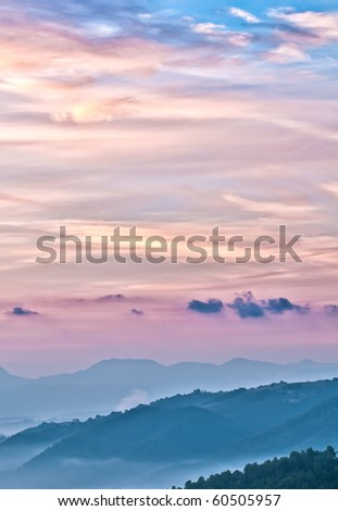 Misty Italian dawn landscape - stock photo