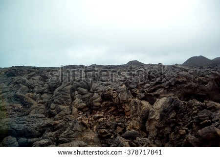 Misty Lava and Volcanic landscape in Timanfaya National Park  in Lanzarote, Canary Islands - stock photo
