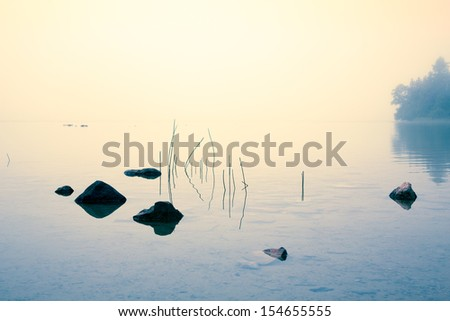 Misty morning at Cyprus lake in Bruce Peninsula, Ontario, Canada - stock photo