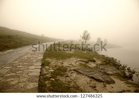 Misty morning by Lago Enol in the mountains of Picos de Europa - Asturias, Spain. - stock photo