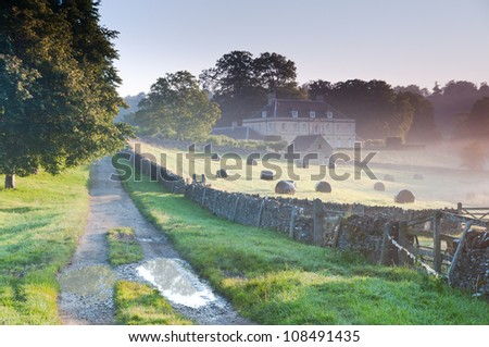 Misty morning in Cotswolds countryside ,England - stock photo