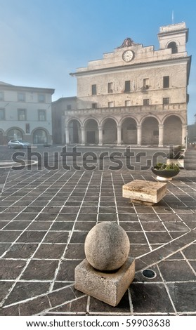 Misty morning in main square, Montefalco, Italy - stock photo
