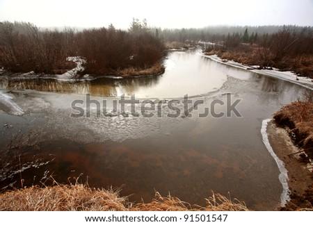 Misty Morning Lake  in Spring Saskatchewan - stock photo