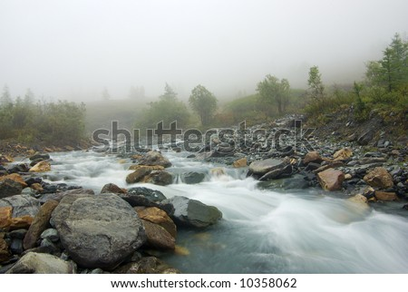 misty morning mountain river junction - stock photo