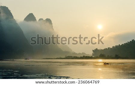 Misty morning on the river at sunrise - The Li River, Xingping - stock photo